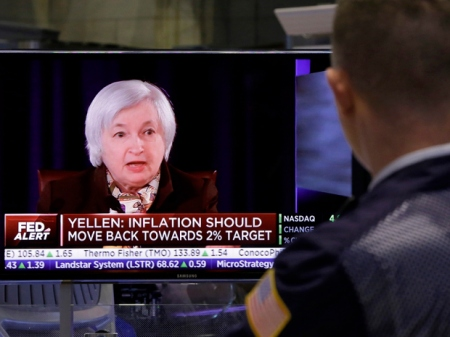 """A trader on the floor of the New York Stock Exchange watches Federal reserve Chair Janet Yellen's news conference, Wednesday, March 18, 2015. The Federal Reserve is signaling that it's edging closer to raising interest rates from record lows in light of a strengthening job market. The Fed no longer says it will be """"patient"""" in starting to raise its benchmark rate. (AP Photo/Richard Drew)"""